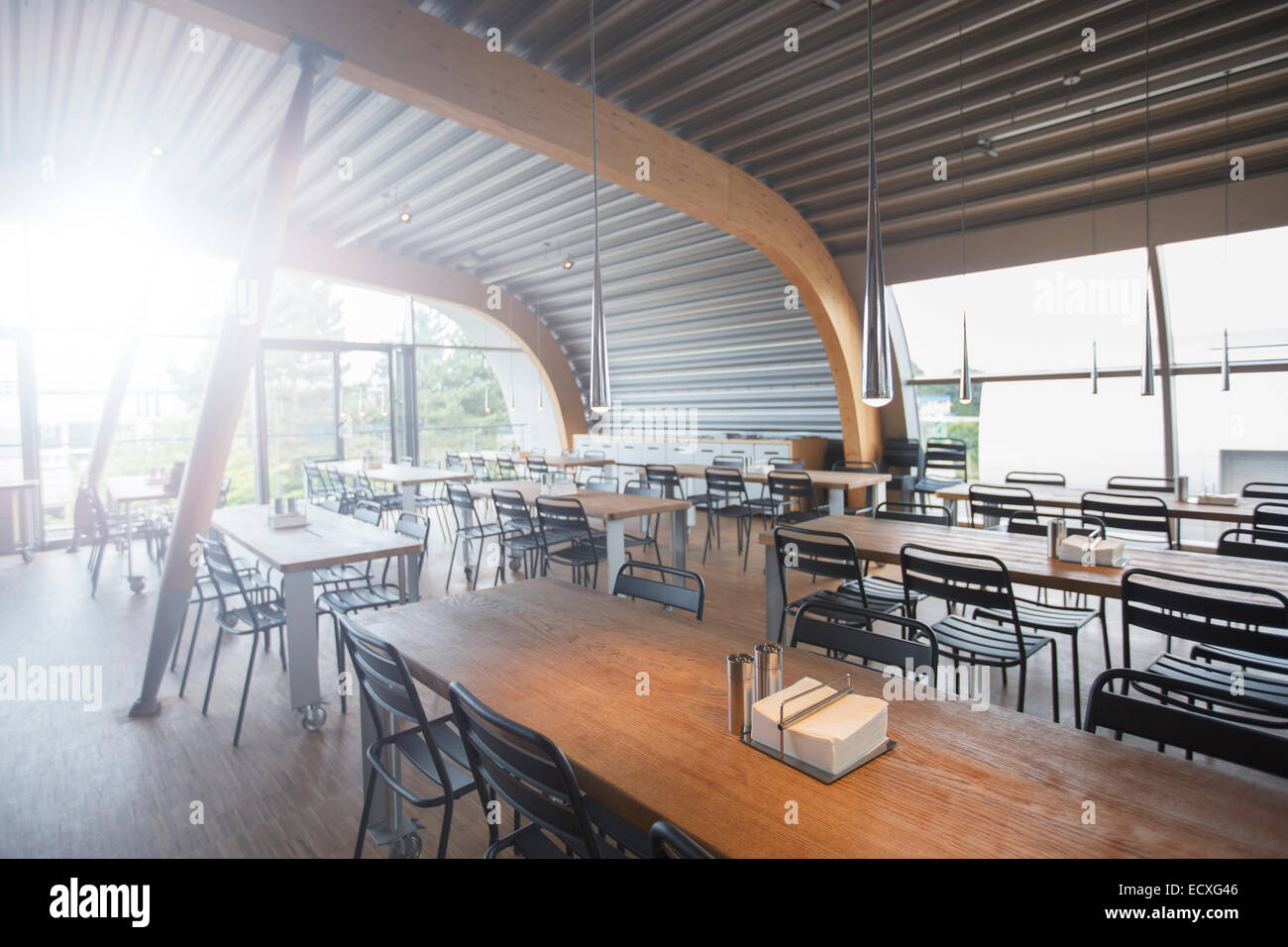 Empty tables in office cafeteria - Stock Image