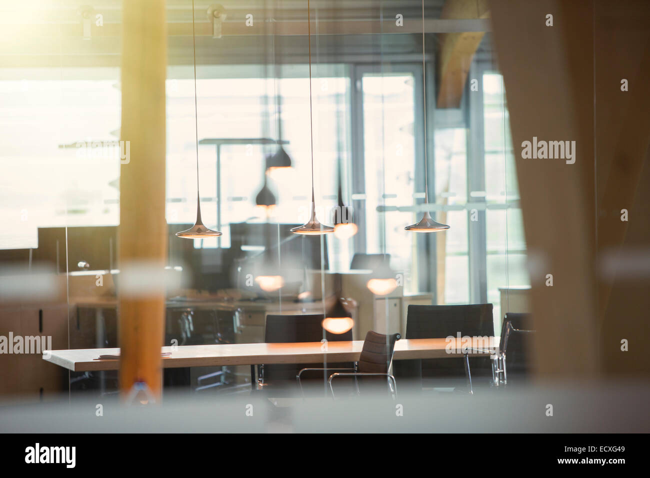 Light fixtures and desks in empty office - Stock Image