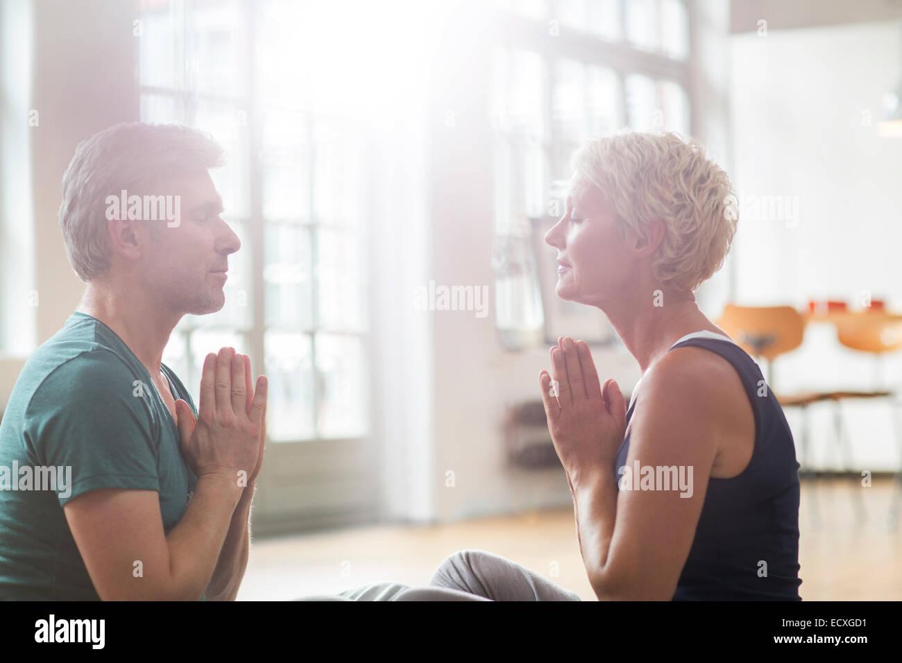 Older couple meditating - Stock Image