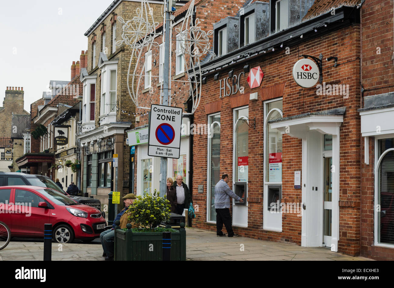 Street view in Pocklington, showing the HSBC bank and a controlled parking zone warning sign. Stock Photo