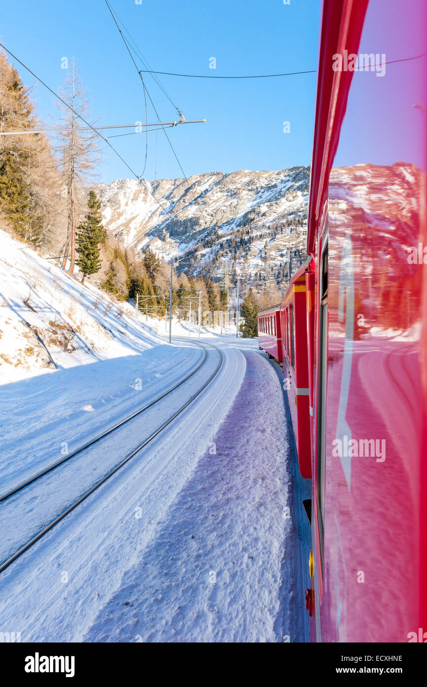 Bernina Express also known as the Little red Train is a railway that join Italy and Switzerland across Alps along - Stock Image