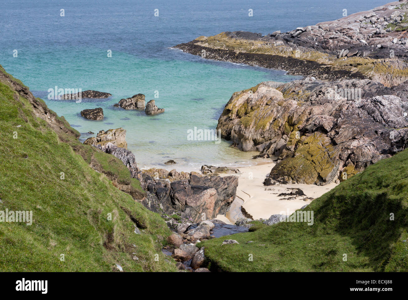 Small rocky beach on the Isle of Harris, Outer Hebrides, Scotland - Stock Image