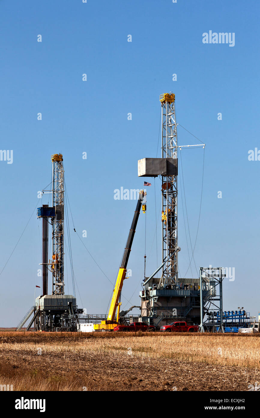Flex drill rigs operating, Williston Basin. - Stock Image