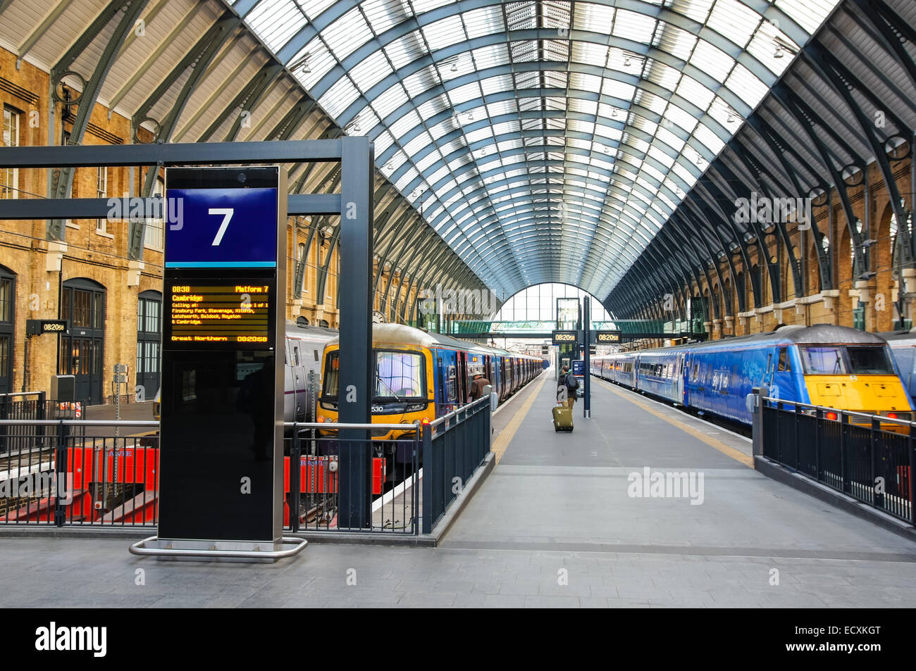Great Northern and East Coast trains on the platform at Kings Cross railway train station, London England United - Stock Image