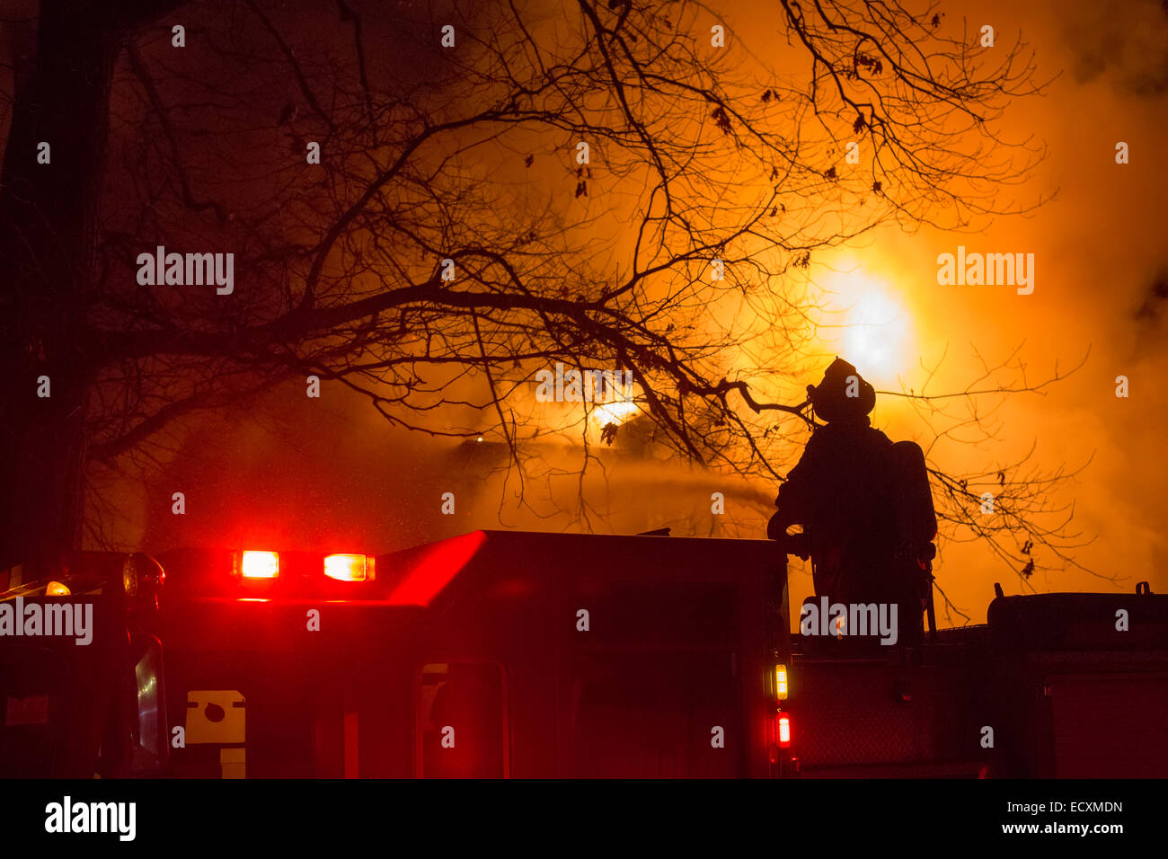 Detroit, Michigan USA - Firefighters battle a fire which destroyed a vacant home in Detroit's Morningside neighborhood. - Stock Image