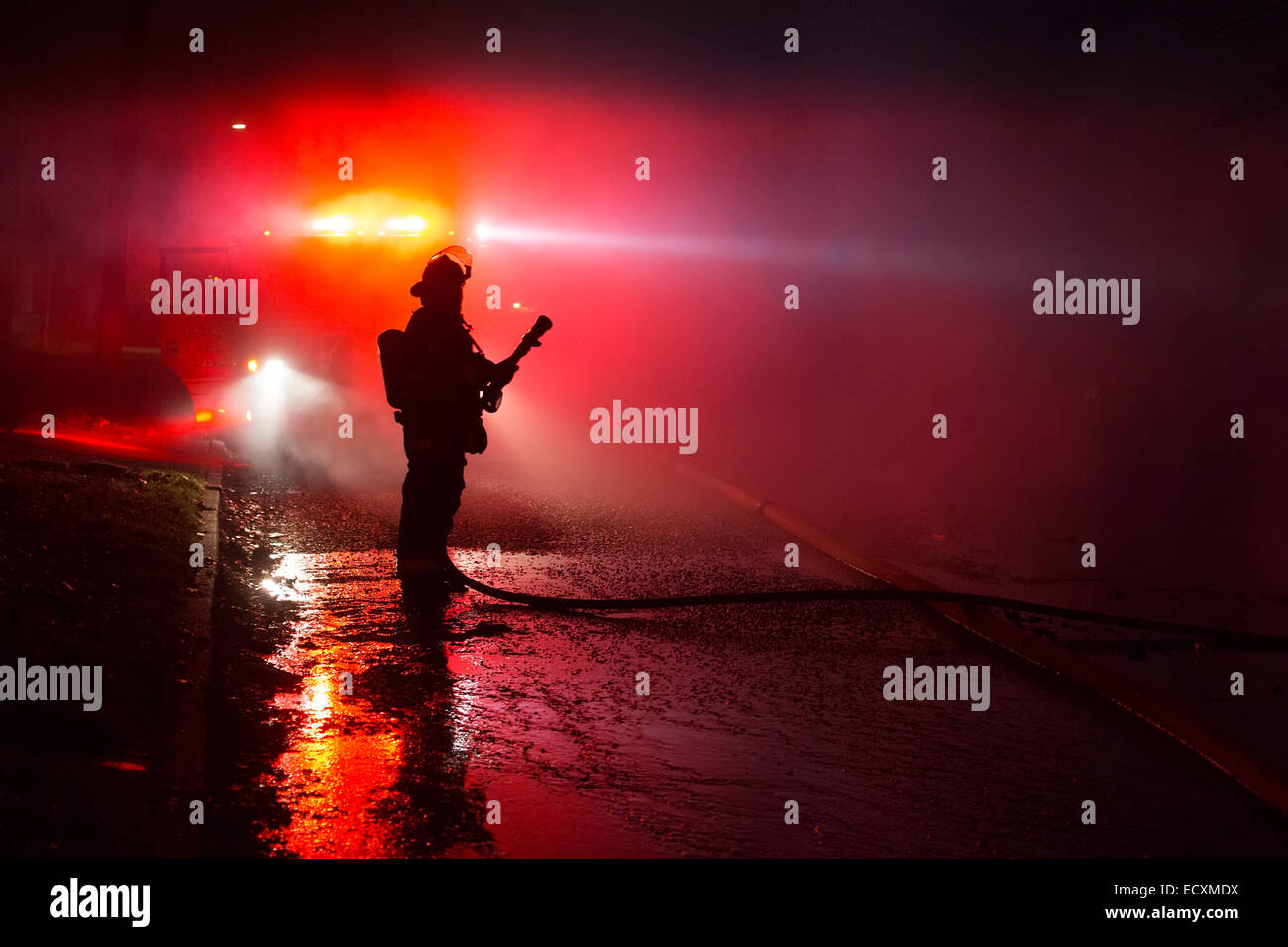 Detroit, Michigan USA - Firefighters battle a fire which destroyed a vacant home in Detroit's Morningside neighborhood. Stock Photo