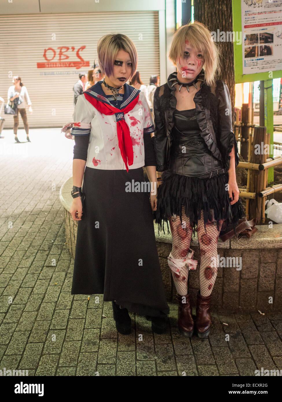 two girls in halloween costumes in shibuya