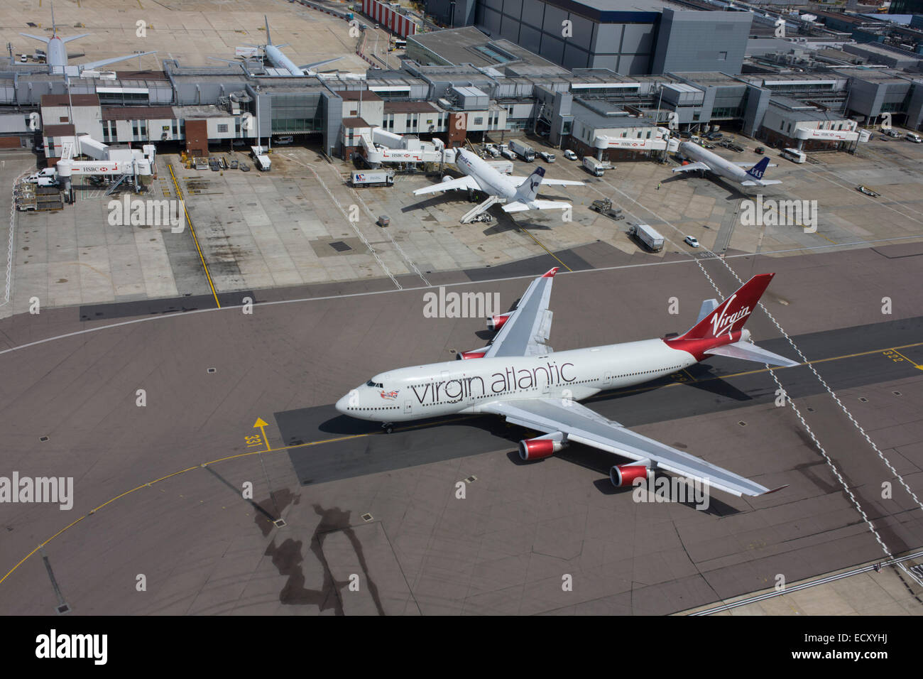 Aerial view (from control tower) of taxiing Virgin Atlantic 747 airliner at London Heathrow airport. - Stock Image