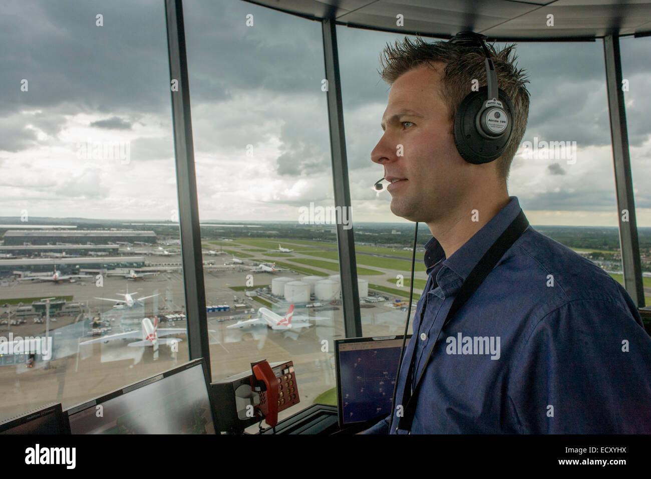 NATS Heathrow air traffic controller in control tower at Heathrow airport, London. - Stock Image