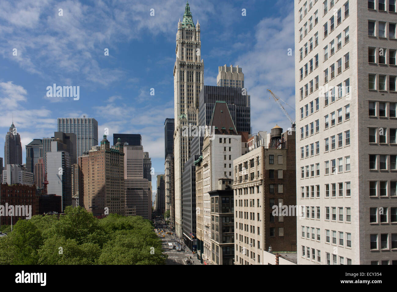 Wide cityscape of skyscrapers looking across Broadway in Manhattan, New York City, with the 1903 Gothic Woolworth - Stock Image