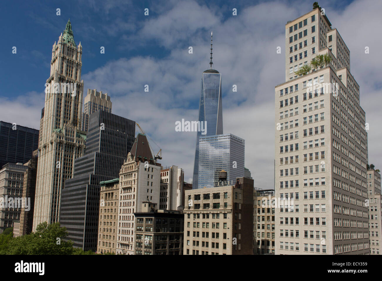 Wide cityscape of skyscrapers looking across Broadway to the modern WTC center in Manhattan, New York City. - Stock Image