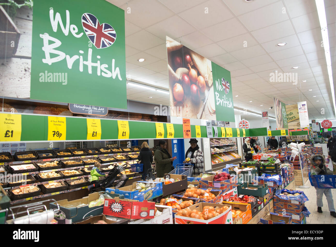 Shoppers buying food essentials in Lidl supermarket, UK - Stock Image