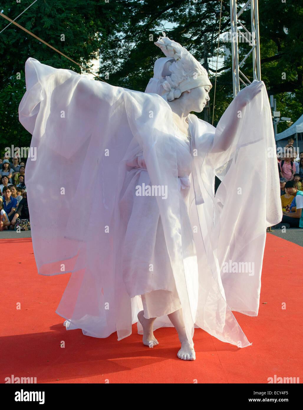 Avant garde butoh artist performing at the Street Show, Bangkok, Thailand - Stock Image