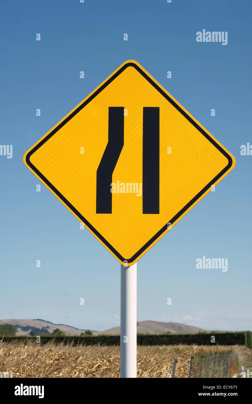 Yellow diamond shape yield sign - Stock Image