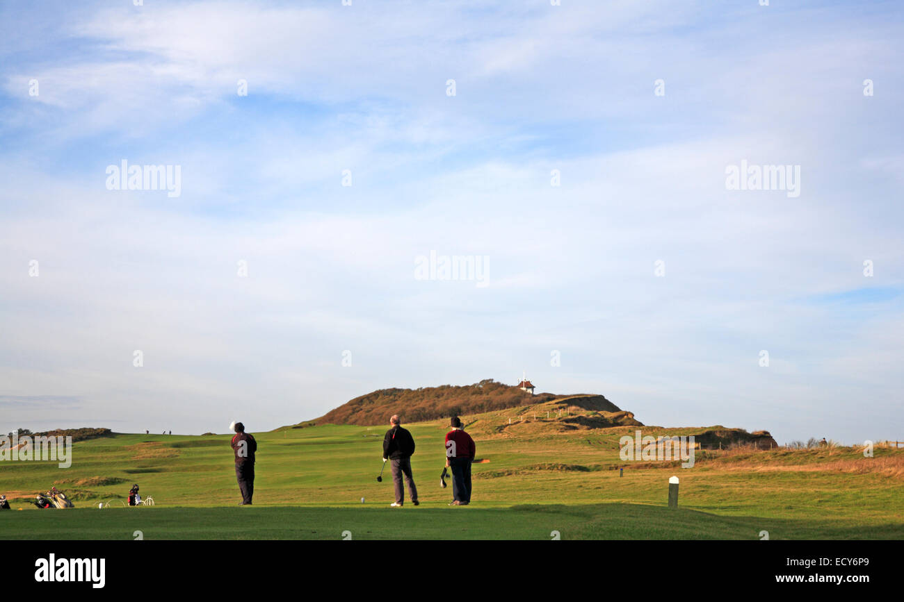 A view of golfers on Sheringham golf course on the coast of Norfolk, England, United Kingdom. - Stock Image