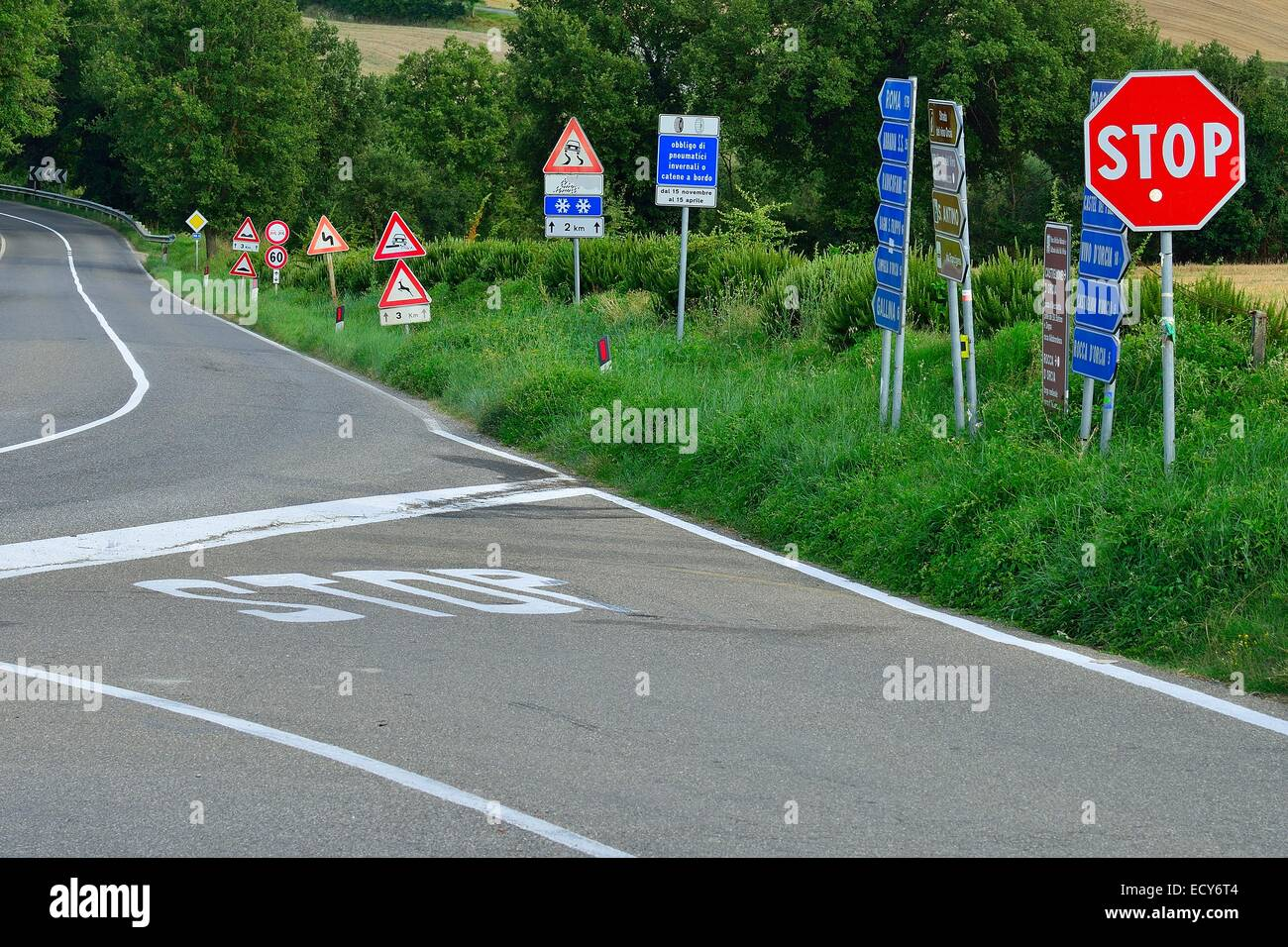 Forest of traffic signs at a crossroads in the Val d'Orcia, Val d'Orcia, Province of Siena, Tuscany, - Stock Image