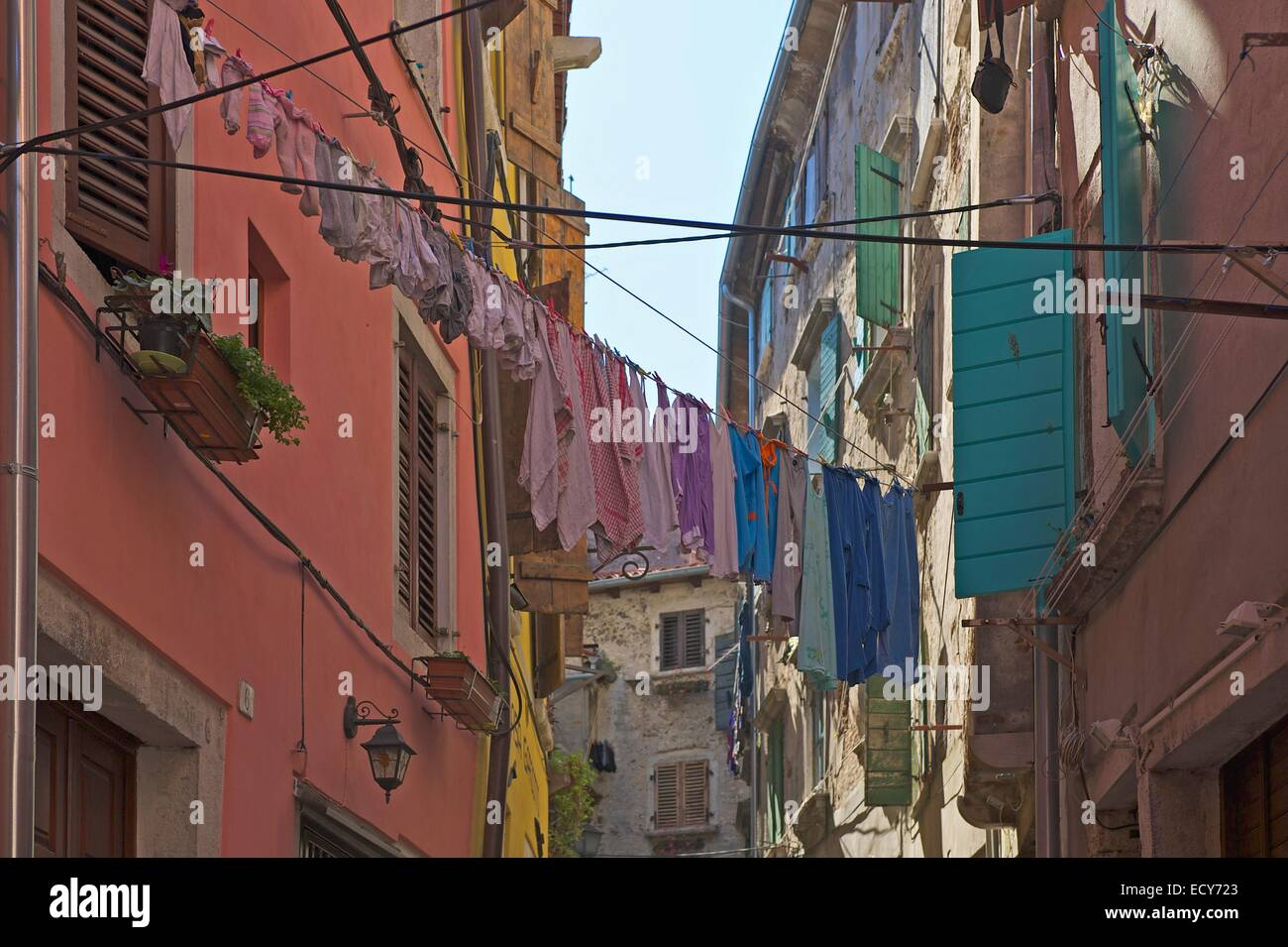 Laundry drying on the line in an alley in the old town, Rovinj, Istria, Croatia - Stock Image