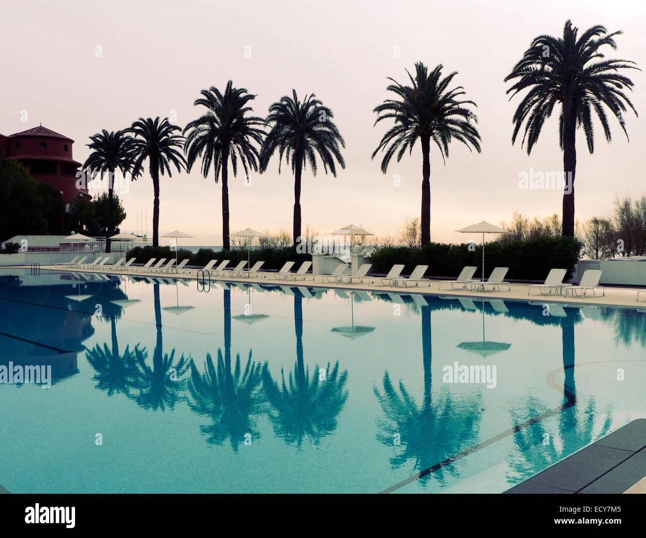 Swimming at the Monte Carlo Beach club Monaco - Stock Image