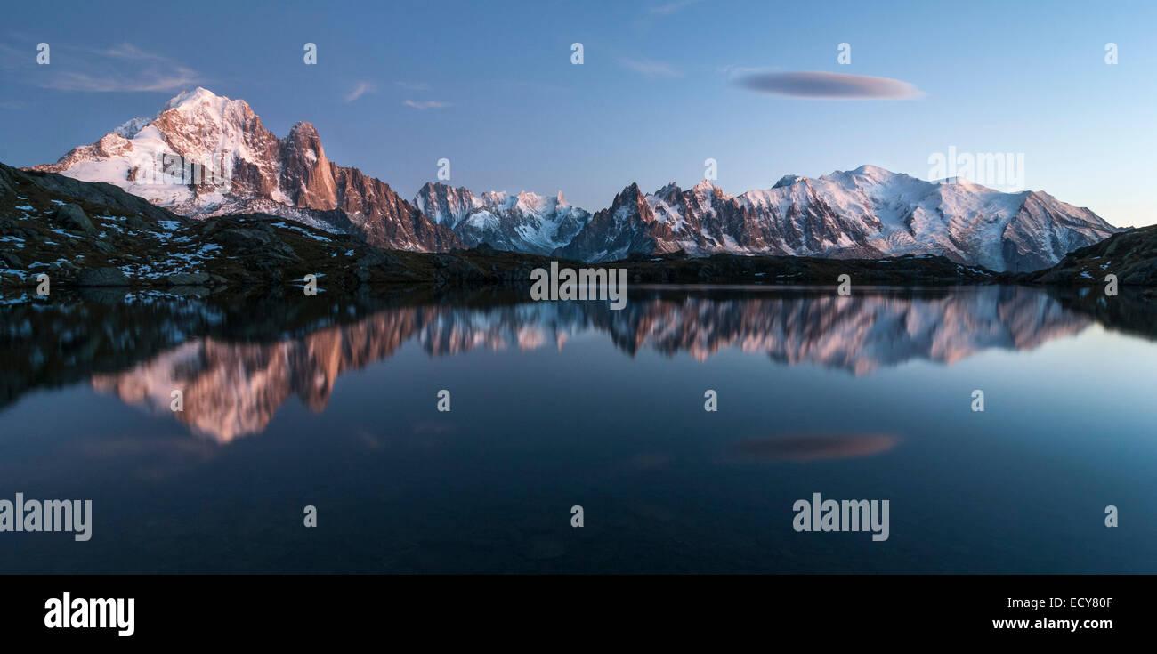Mont Blanc massif reflected in the Lac de Chesery, left Aiguilles de Chamonix, Mont Blanc right, Chamonix, France Stock Photo