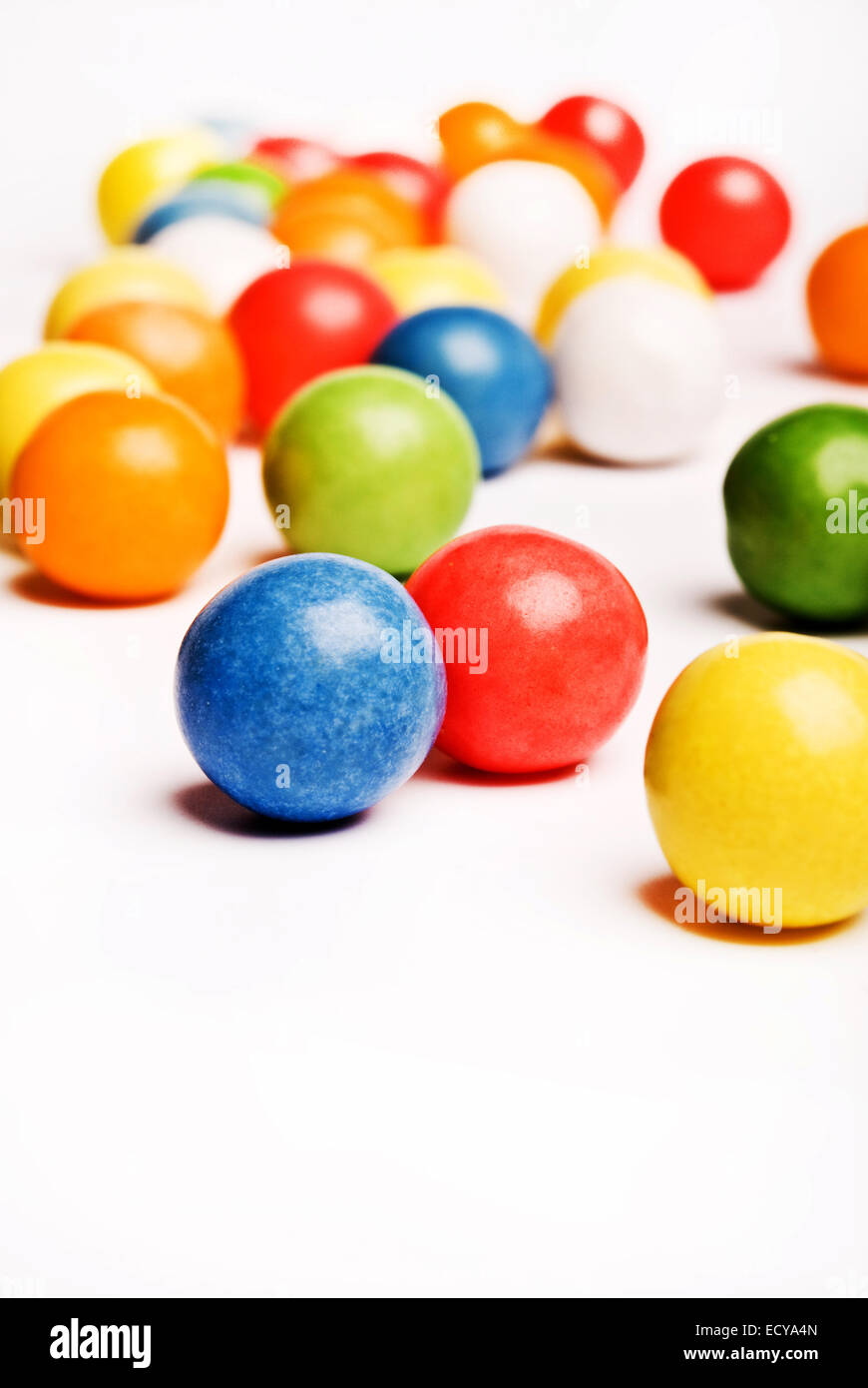 colorful gum-balls on a white background - Stock Image