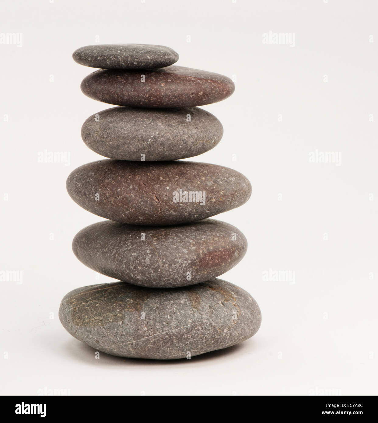Balancing rounded pebbles. - Stock Image