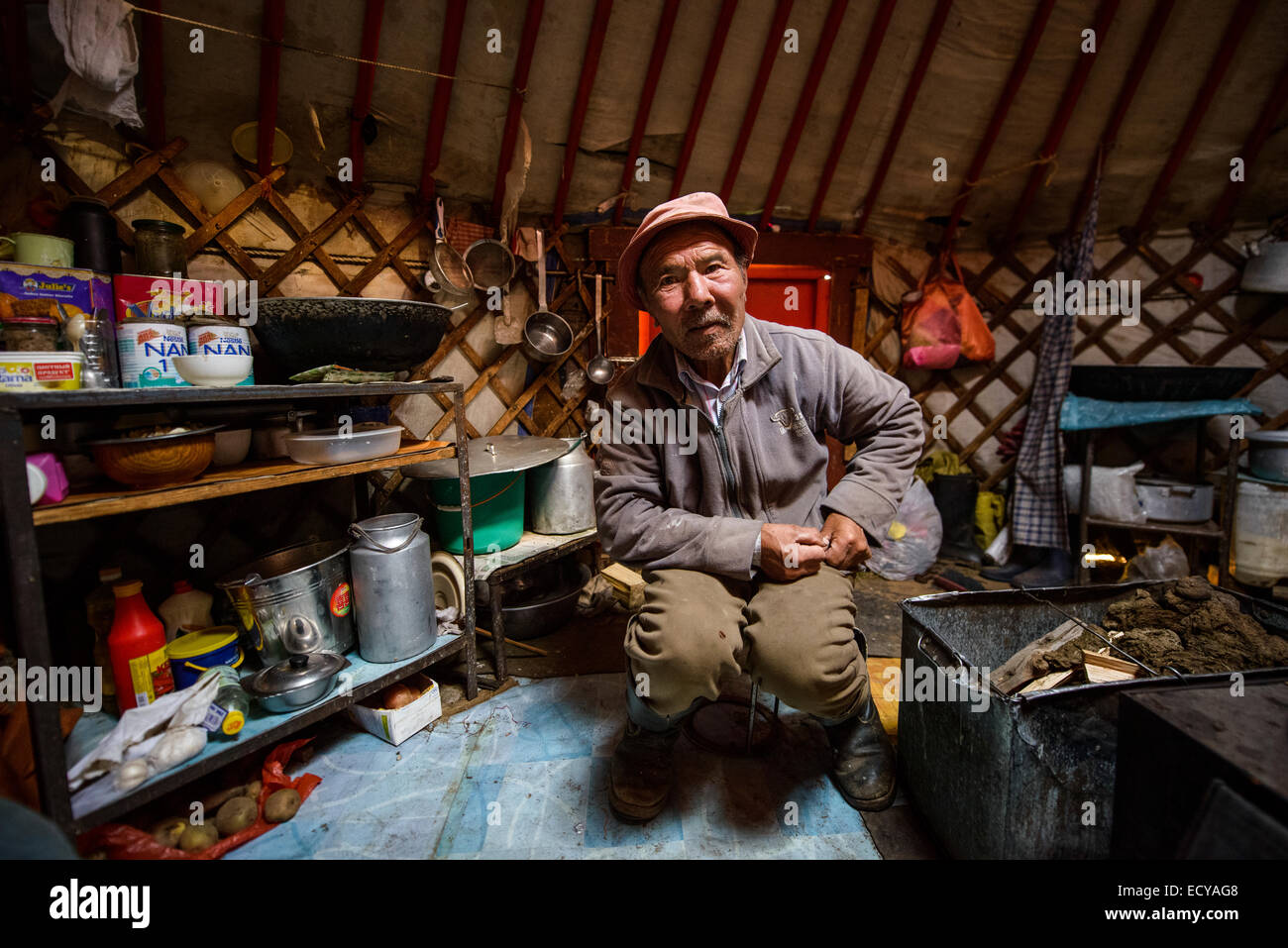 Mongolian nomads inside their gers, Mongolia Stock Photo