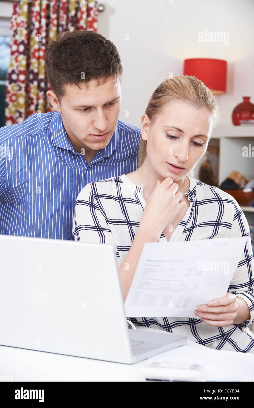 Worried Couple Discussing Domestic Finances At Home - Stock Image
