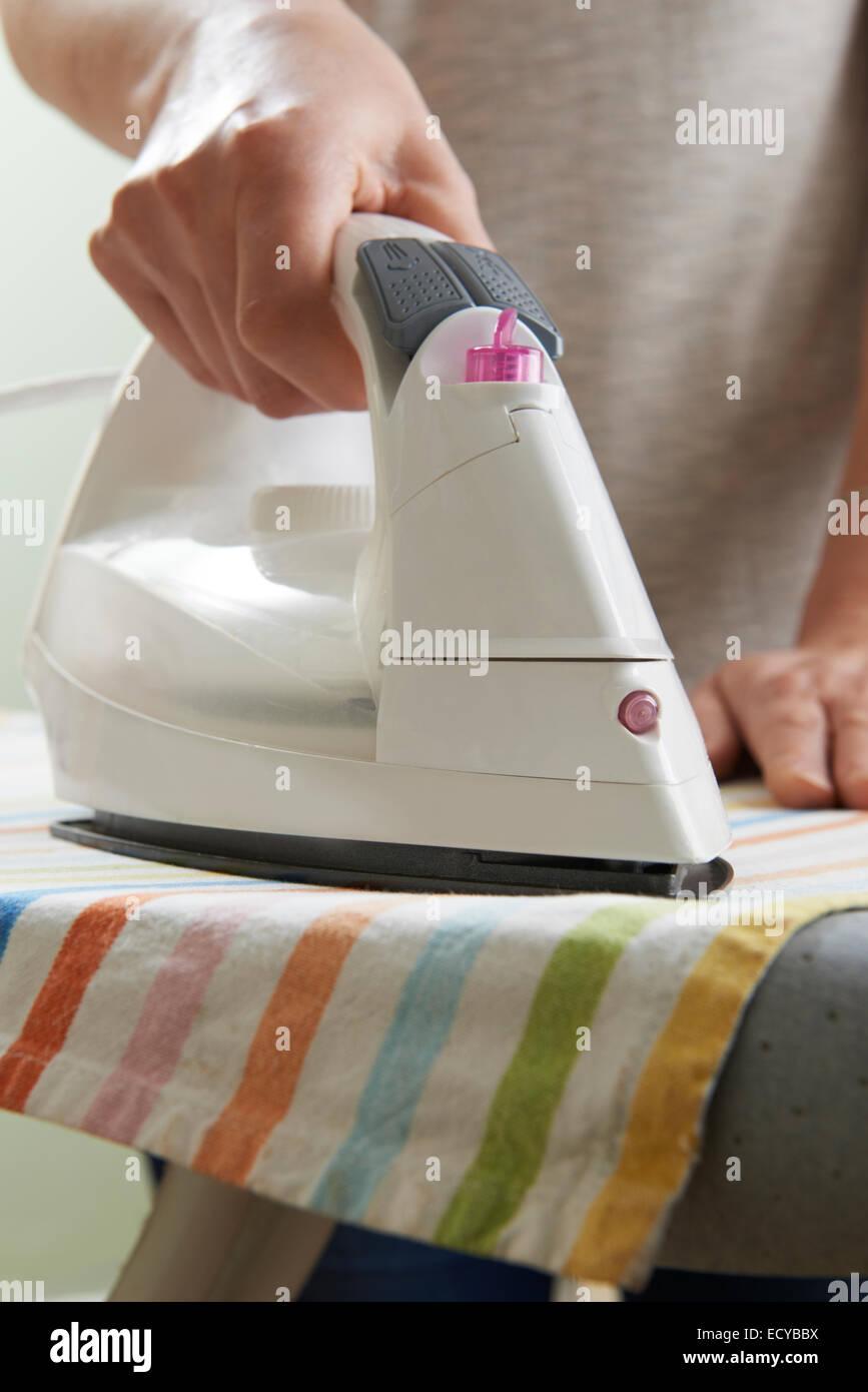 Close Up Of Woman Ironing Laundry - Stock Image