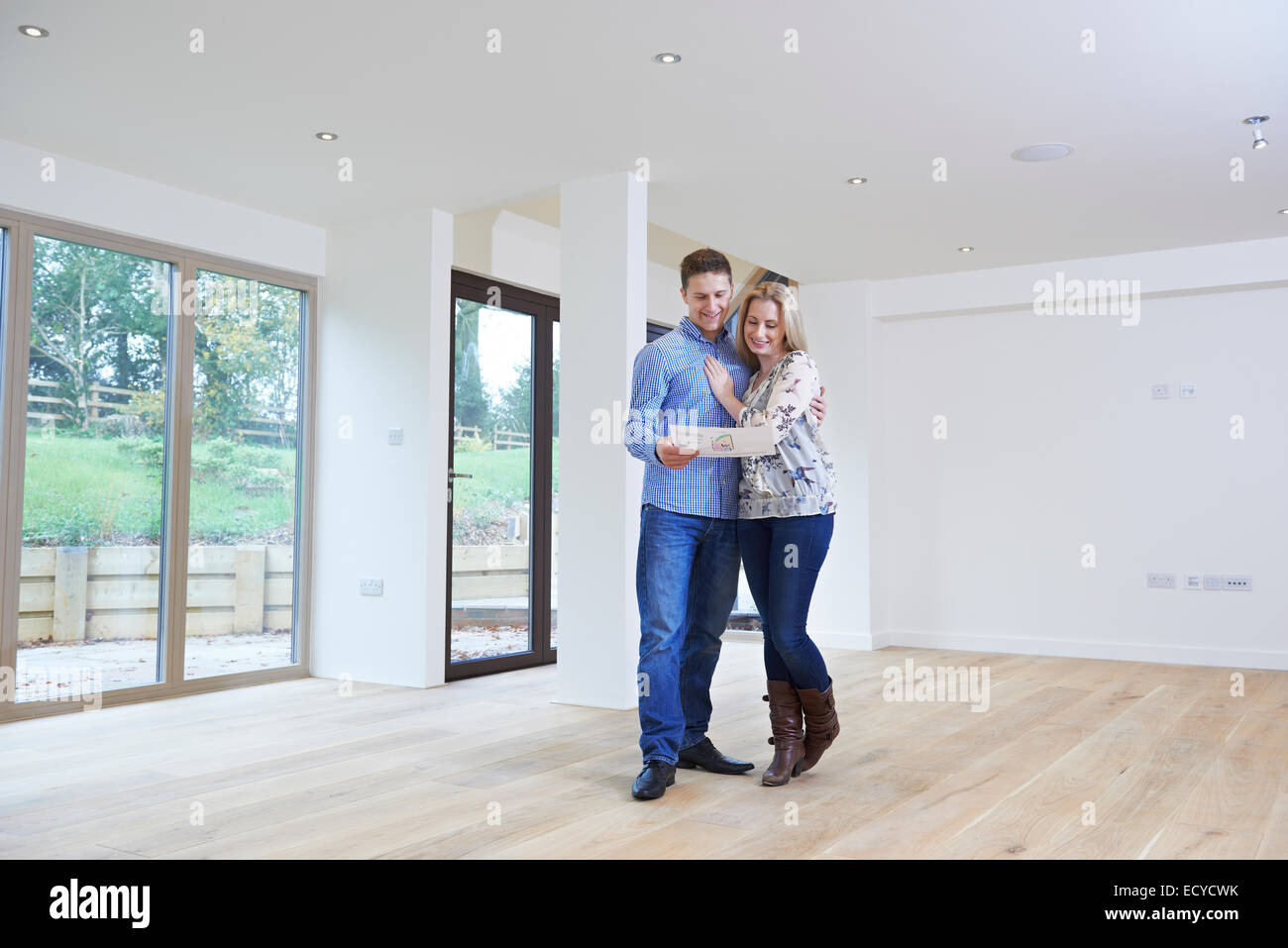Happy Young Couple Looking At Details Of New Home Stock Photo