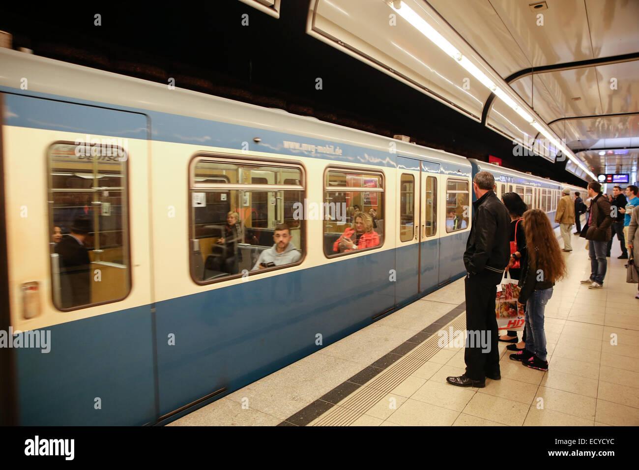 people waiting train inside subway station platform - Stock Image