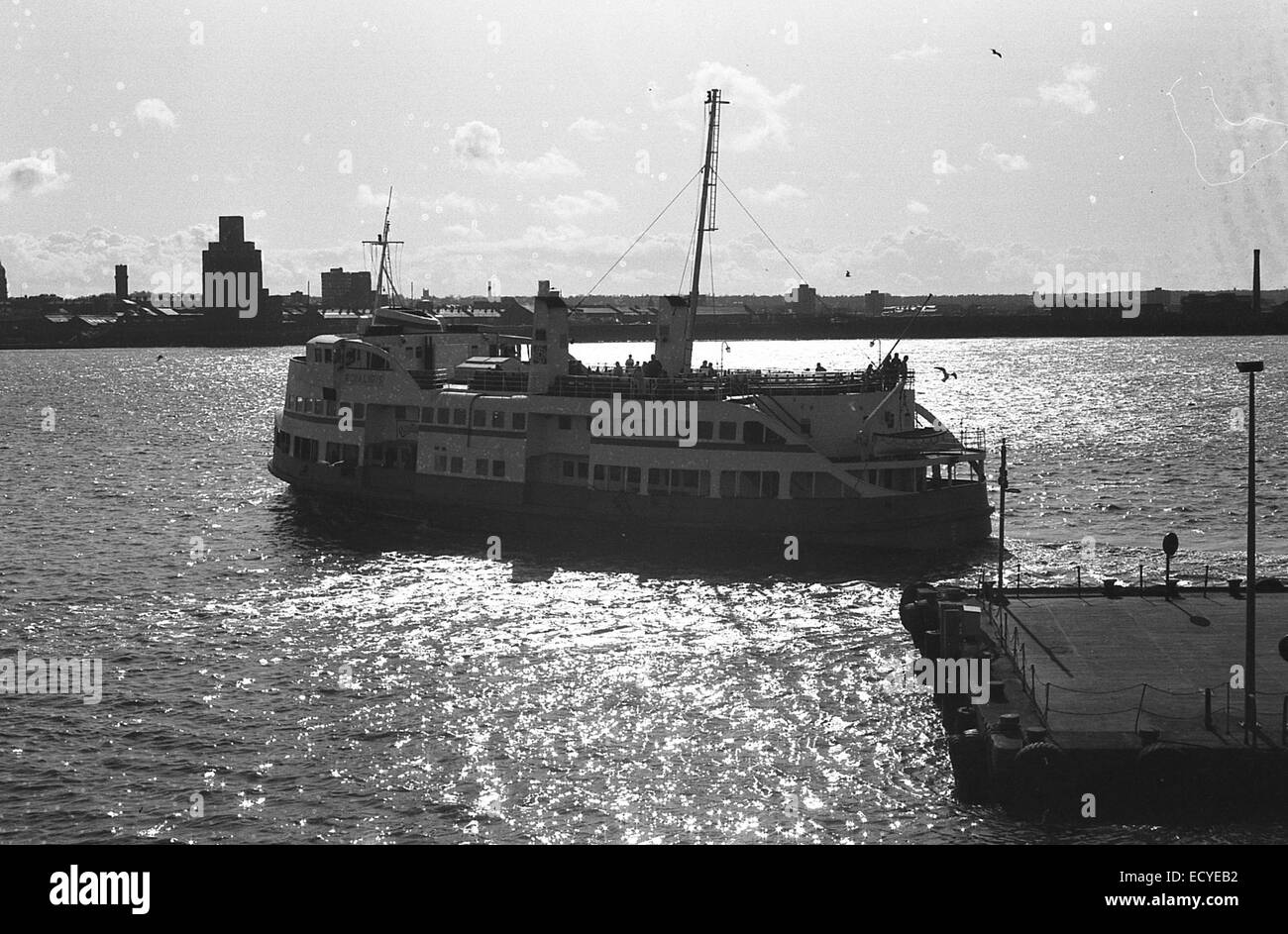 black and white picture of the liverpool ferry boat sailing towards birkenhead on a calm sunny afternoon - Stock Image