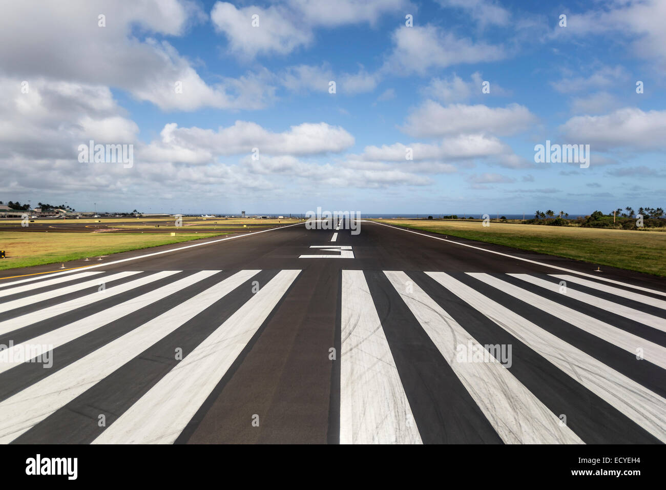 Tropical runway at a regional island airport in Hawaii. - Stock Image