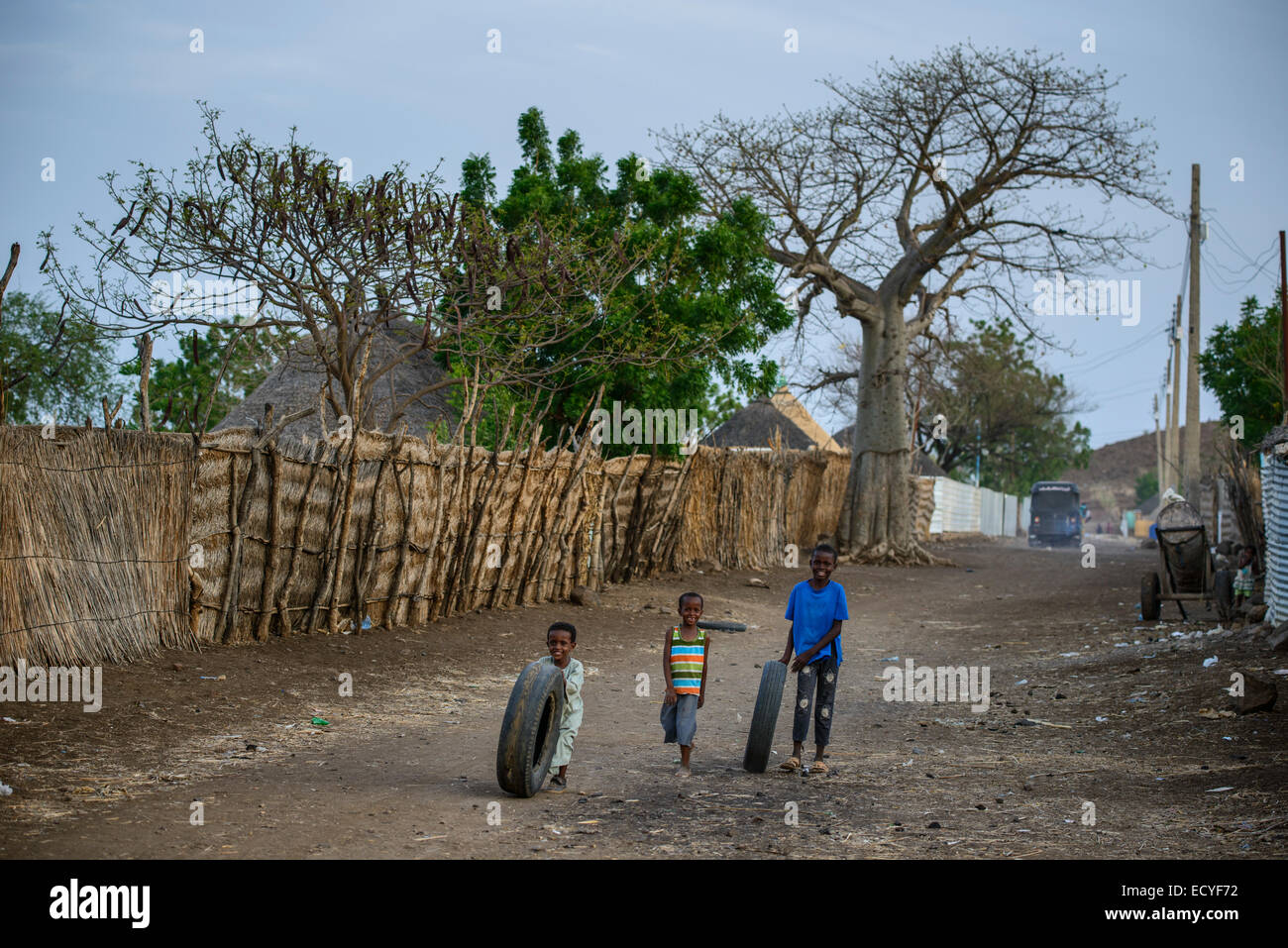 Kids playing with old tires near Al Galabat, Sudan - Stock Image