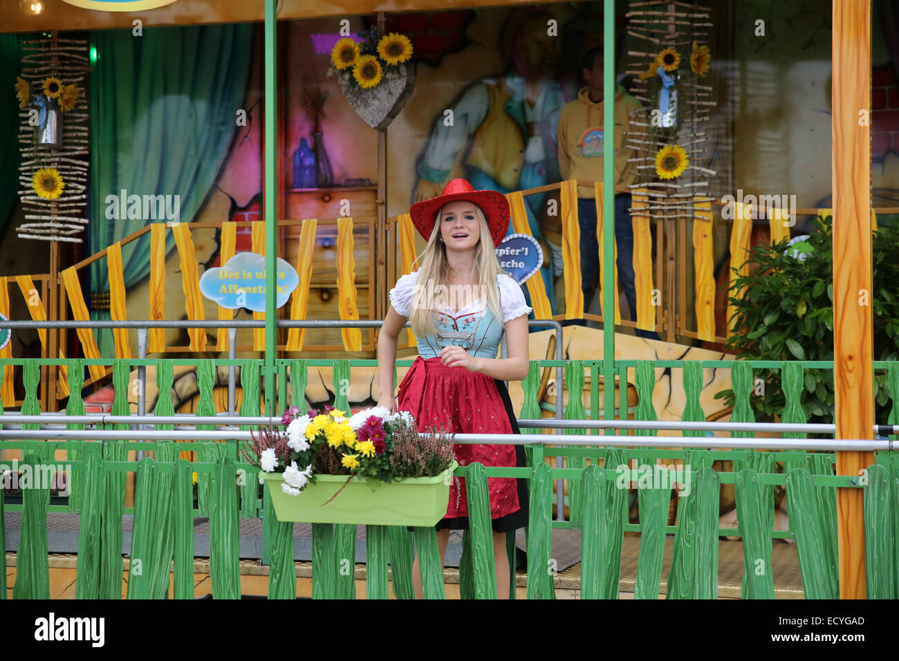 beautiful young German woman singing Munich Oktoberfest Germany Europe - Stock Image