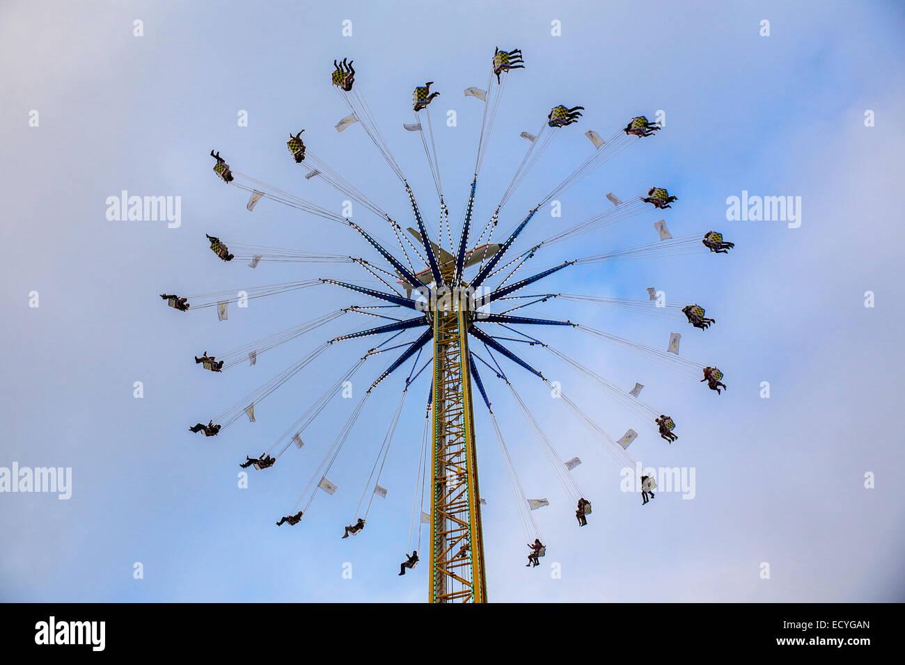 amusement park swing thrill ride scary blue sky - Stock Image