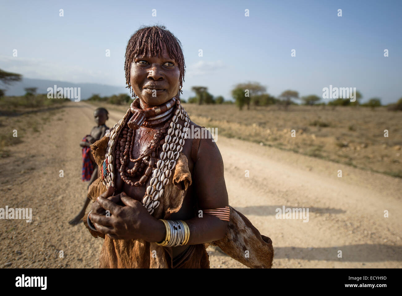 Hamar woman with ochre hair and decorations, Omo Valley, Ethiopia - Stock Image