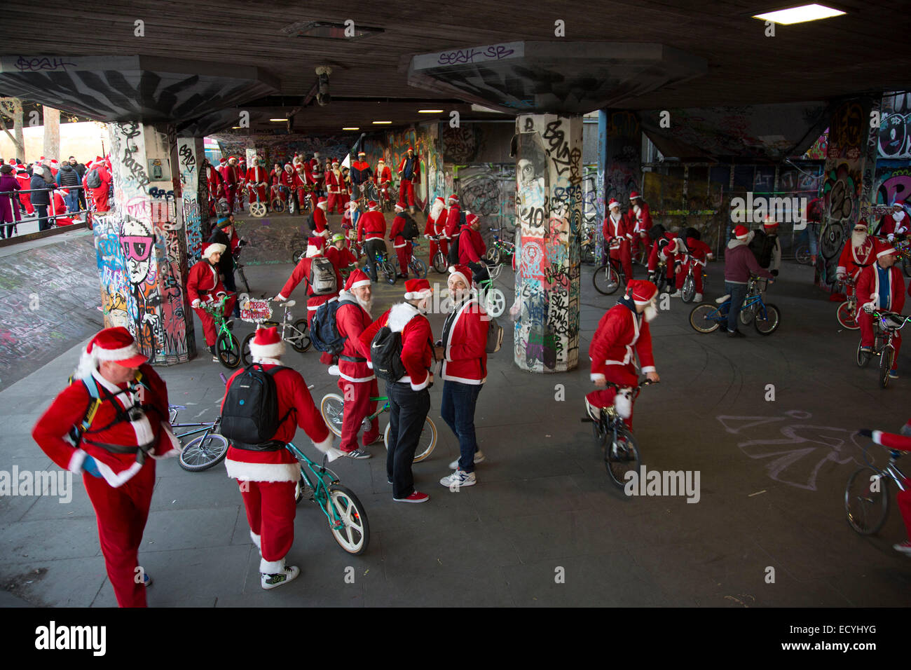 Santas of Old School BMX Life on the Santa Cruise charity day out. Undercroft, South Bank, London, UK. - Stock Image