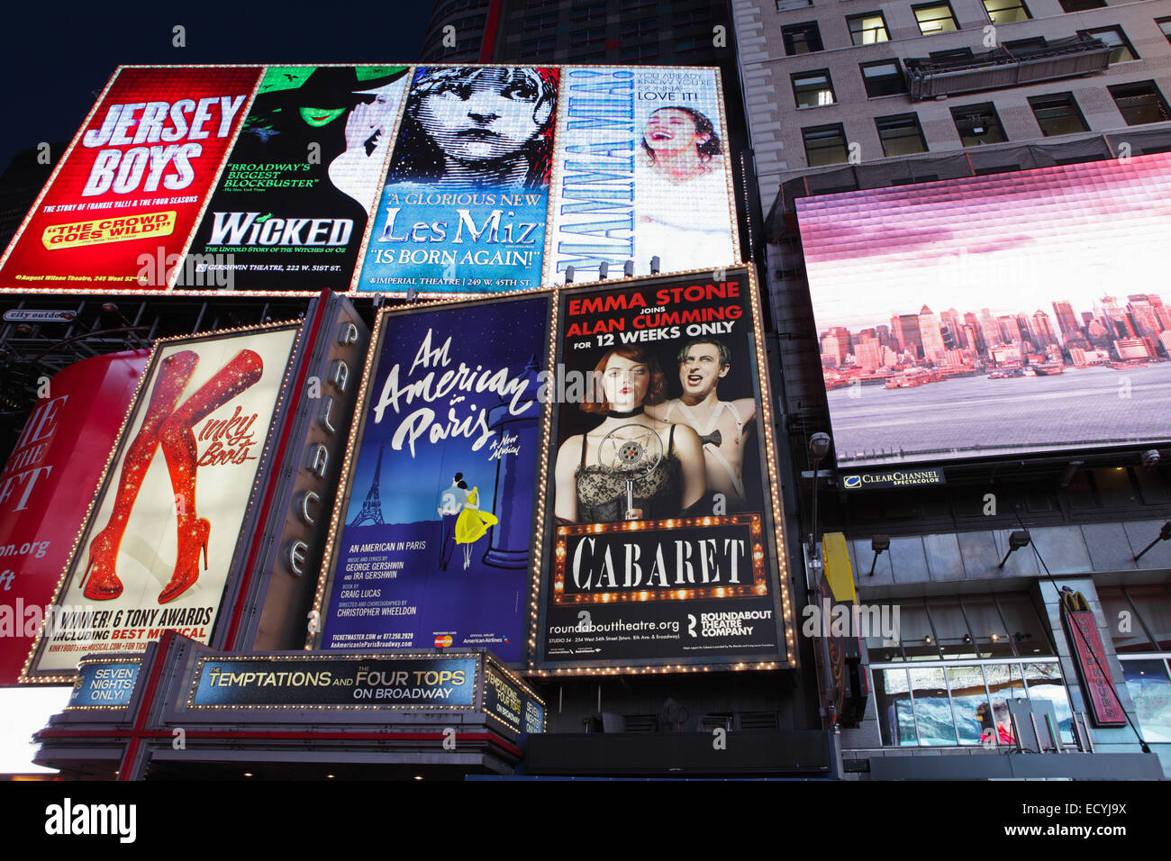 Electronic billboards in Times Square New York advertising theatre shows - Stock Image