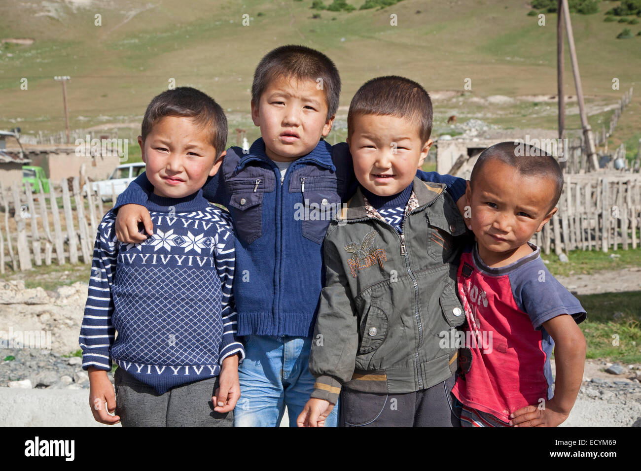 Four young Kyrgyz boys showing Chinese features, Osh Province, Kyrgyzstan - Stock Image