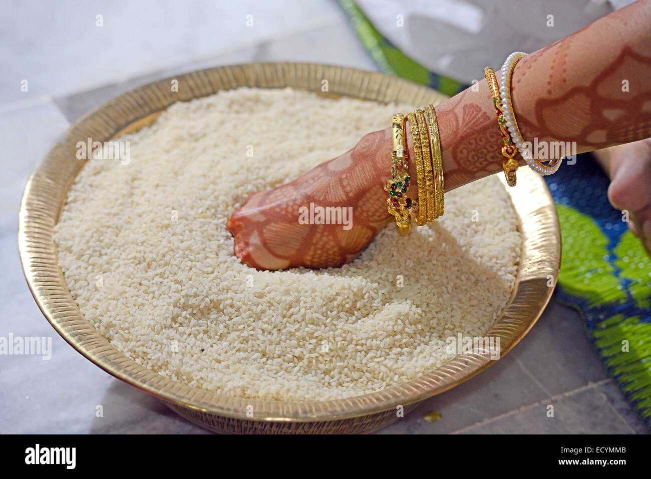 traditional Indian post-marriage ceremony bride rice plate hand Stock Photo