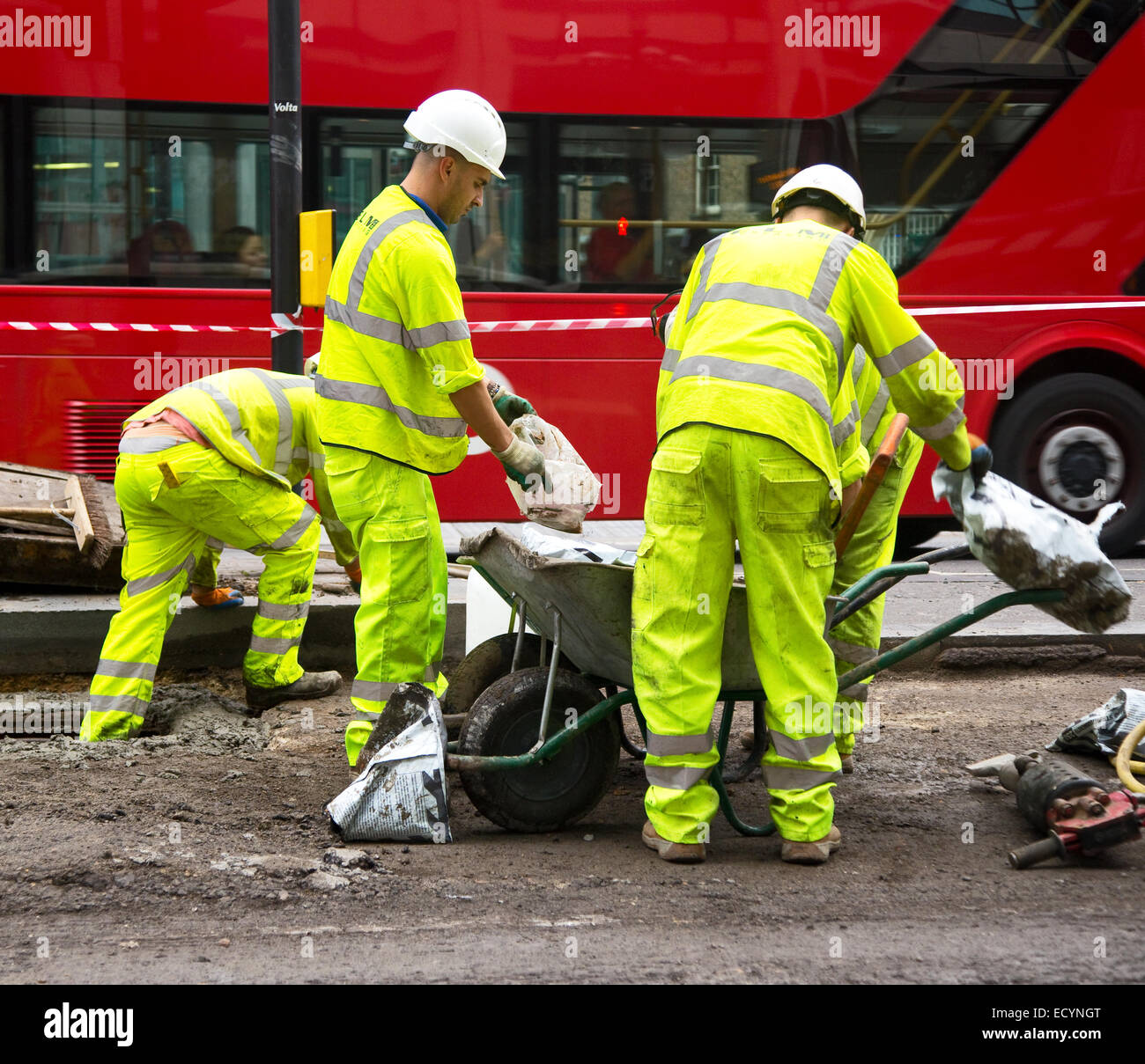 LONDON - OCTOBER 18TH: Unidentified workman preparing a mixture on October 18th, 2014 in London, England, UK. The - Stock Image