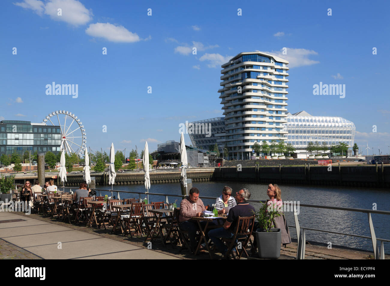 Cafe at Dalmannkai, view to Marco  Polo Tower and Unilever building, Hafencity, Hamburg, Germany, Europe - Stock Image
