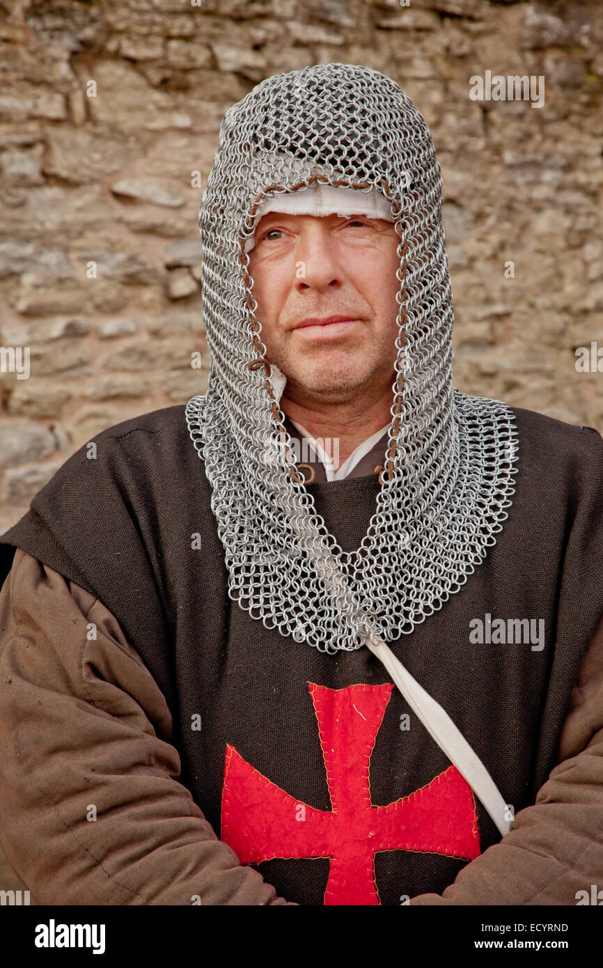 Man dressed in medieval light armour and gown, Christmas fayre, Ludlow Shropshire UK - Stock Image