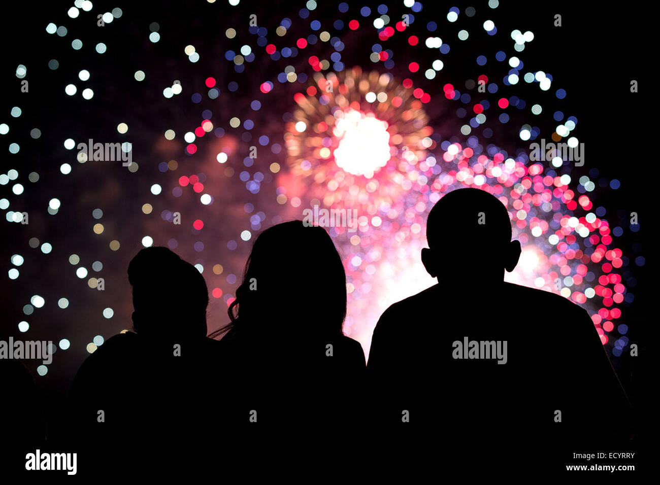 President Barack Obama, First Lady Michelle Obama, and Malia Obama, center, watch the Fourth of July fireworks from - Stock Image