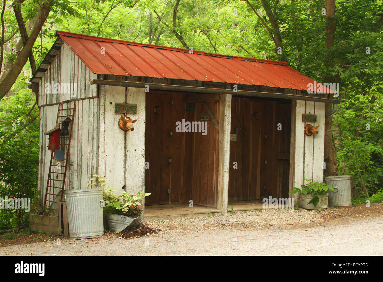 Mens and Womens Outhouse Restrooms. Doors are labeled Bucks and Does. Rabbit Hash, Kentucky, USA. Circa 1813. A - Stock Image