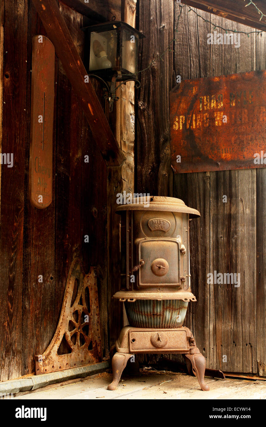 Old Pot Belly Stove. Name plate identification is Mity Oak. Rabbit Hash, Kentucky, USA. Circa 1813. A historic small - Stock Image
