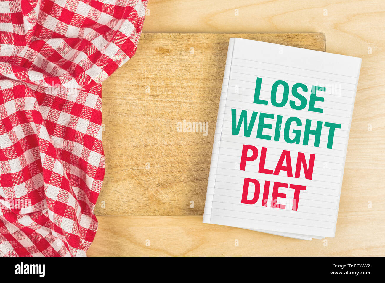 Lose Weight Plan Diet Message in NoteBook on Kitchen Table. - Stock Image