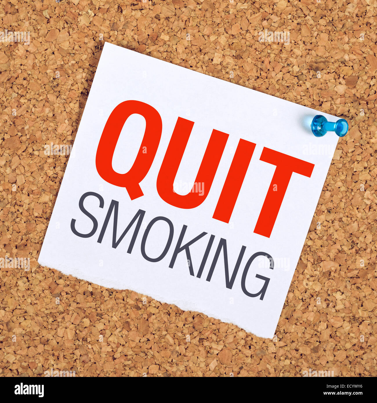 Quit Smoking Reminder Note pinned to A Cork Memory Bulletin Board. - Stock Image