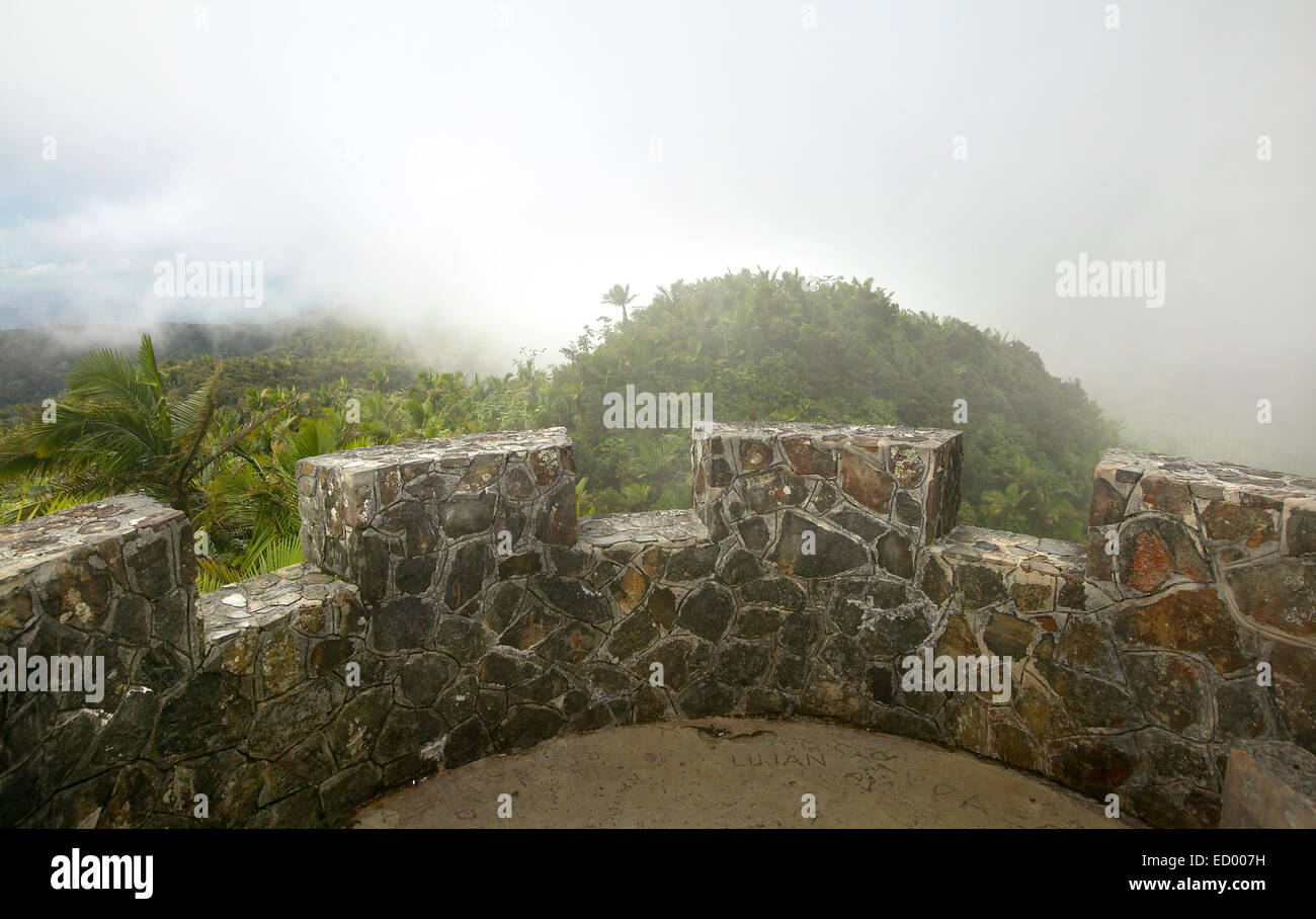 view from atop Mount Briton Tower in El Yunque rainforest with clouds rolling in Stock Photo