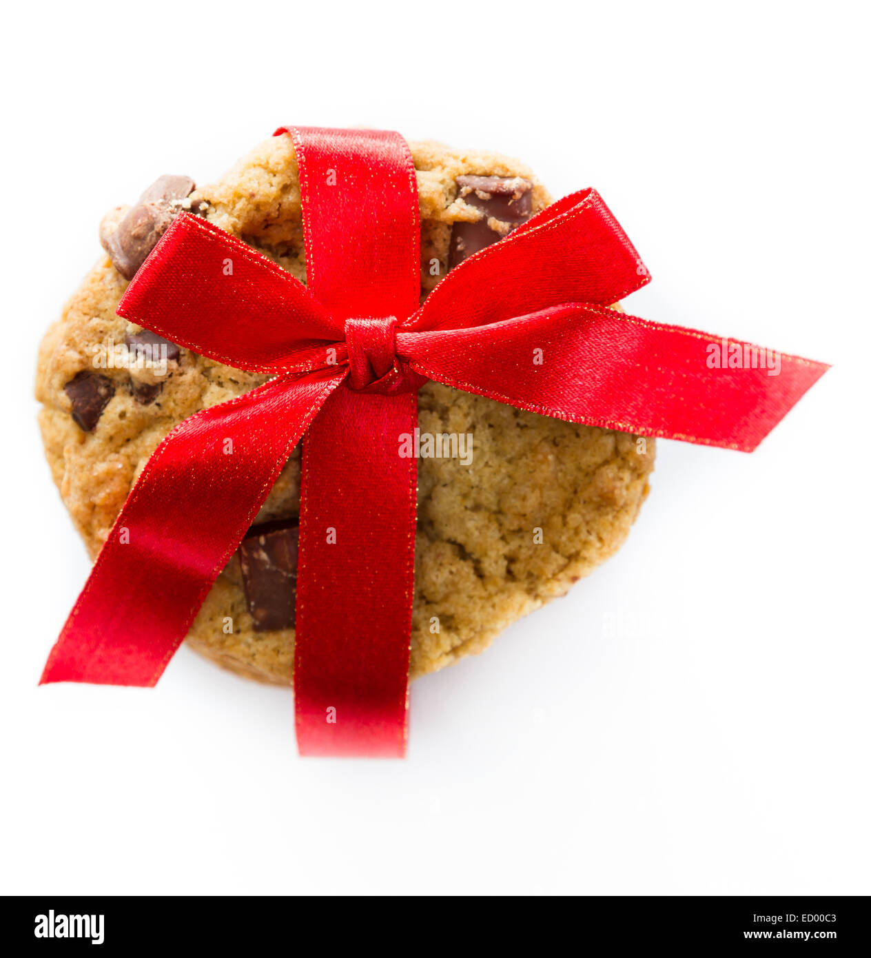 close up of home made chocolate chip cookies with a red ribbon  isolated on a white background - Stock Image